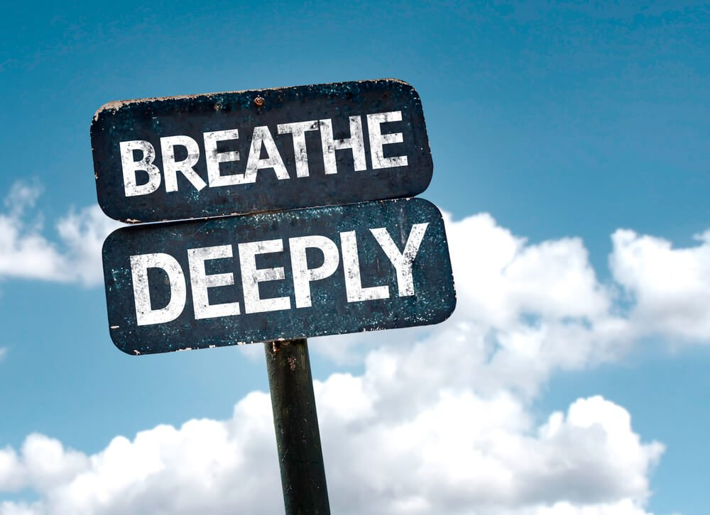 sign reading breathe deeply