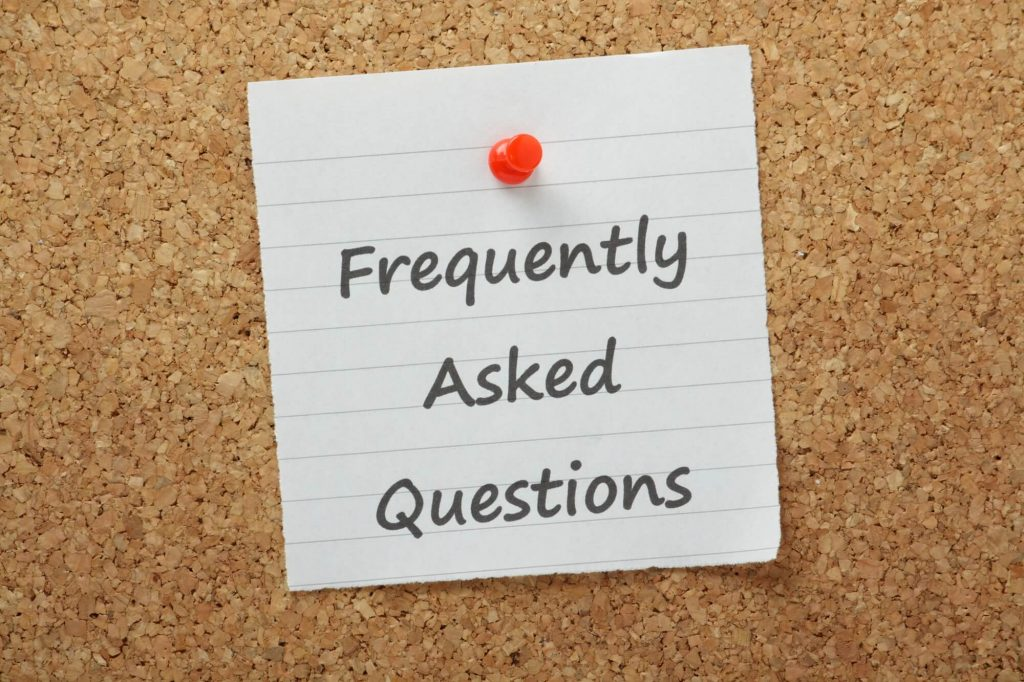 post it on board reading frequently asked questions
