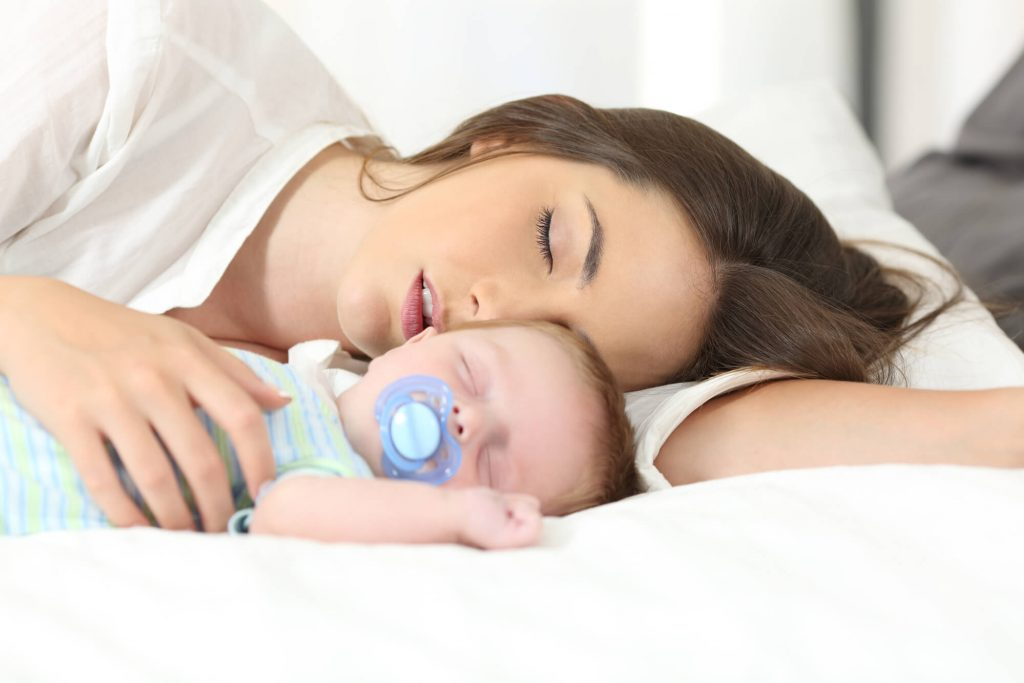 Mom and baby sleeping after breastfeeding and let down reflex