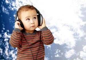 toddler listening to kid friendly song with headphones