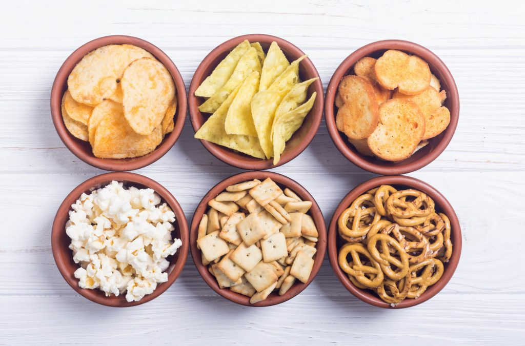 6 small bowls with a variety of snacks- chips, popcorn, pretzels, etc. (snacks for kids when traveling)