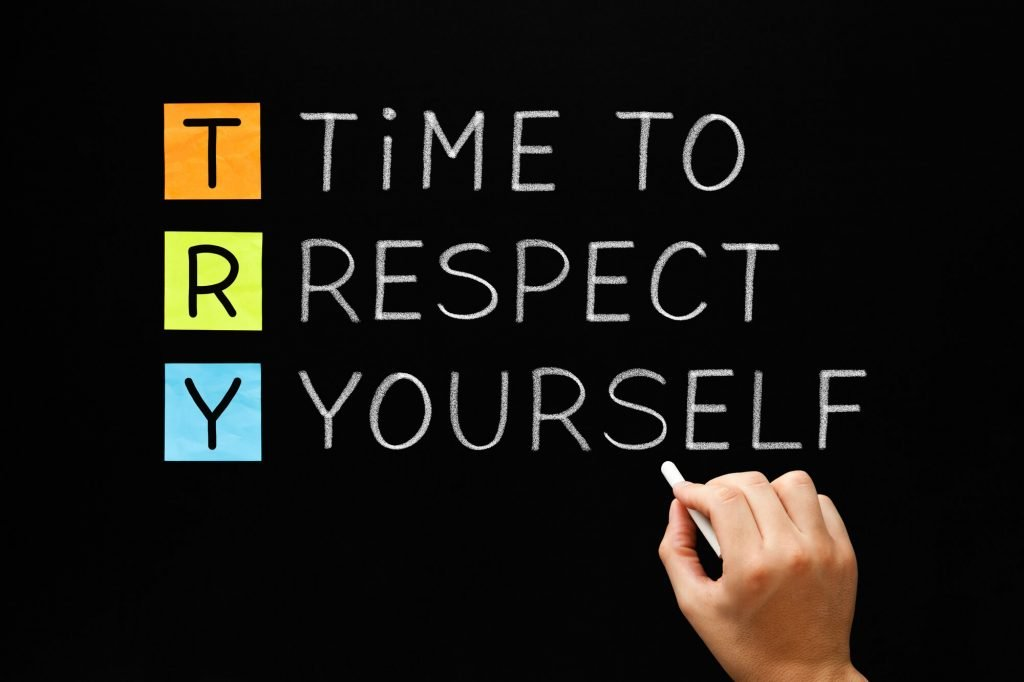 "hand writing on chalkboard ""time to respect yourself"""